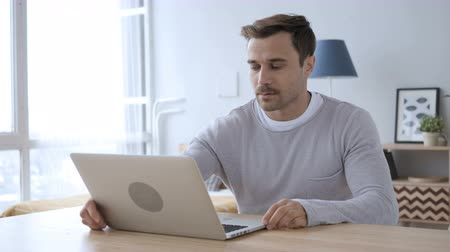 desperate student : Creative Adult Man Coming for Doing Work on Laptop at Desk
