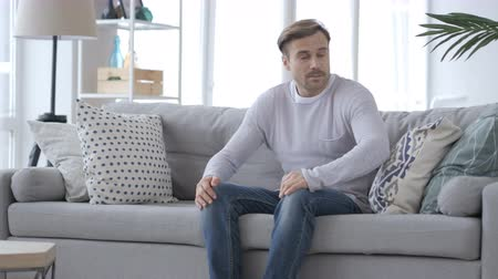 desperate student : Adult Man Coming and Sitting on Couch in Room