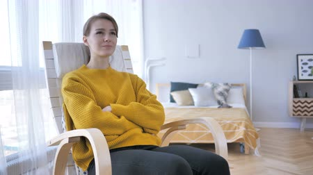 рассмотрение : Young Woman Sitting on Casual Chair, Brainstorming