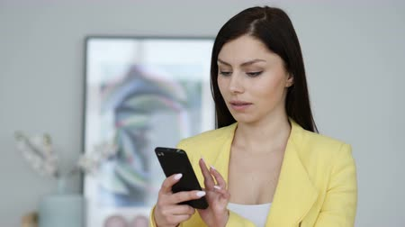 web browser : Woman Using Smartphone for Browsing Internet Stock Footage