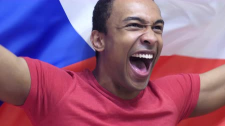 watching : Czech Fan celebrating while holding the flag of Czech Republic in Slow Motion