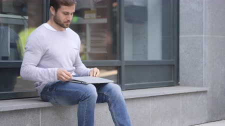 desperate student : Handsome Man Leaving after Sitting on Stairs and working on Laptop
