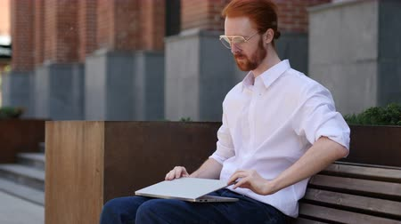desperate student : Designer Leaving after Sitting on Bench and working on Laptop Stock Footage