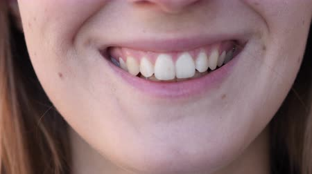 emin : Close up of Smiling Woman Teeth and Lips