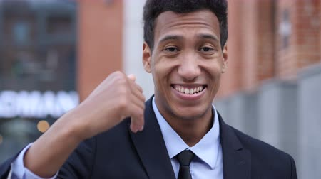 ações : Inviting Gesture by Young African Businessman Stock Footage
