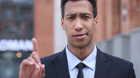 níveis : No, African Businessman Rejecting Offer by Waving Finger Stock Footage