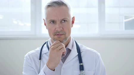 introspection : Pensive Doctor Thinking about Patient Health