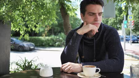 терраса : Thinking Young Man Sitting in Cafe Terrace