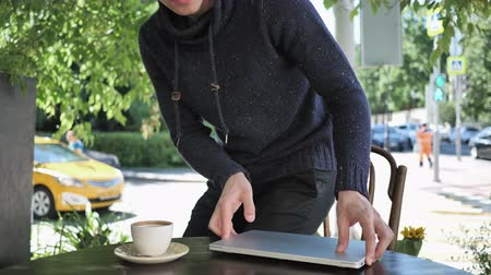 desperate student : Man Coming and Sitting in Cafe Terrace and Opening on Laptop Stock Footage
