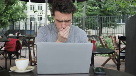 infectious : Sick Young Working Man Coughing while Sitting in Cafe Terrace Stock Footage