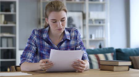 use laptop : Documentation, Young Woman Reading Contract in Casual Office