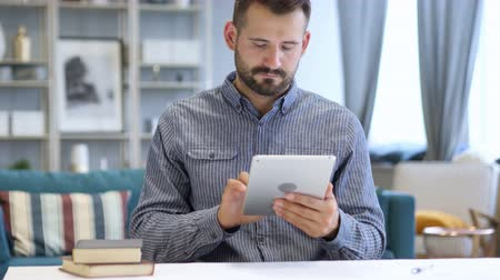 tab : Man Using Tablet at Workplace Stock Footage
