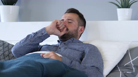 coughing : Sick Man Coughing while Lying in Bed Stock Footage