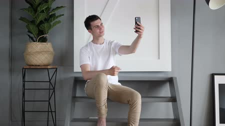 görgetés : Casual Man Taking Selfie with Phone, Photograph
