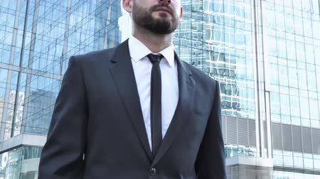 bankier : Young Businessman Walking on Street Wideo