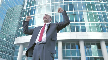 bankier : Middle Aged Businessman Celebrating Success Outside Office
