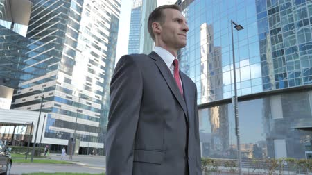 преуспевать : Middle Aged Businessman Standing Outside Office Стоковые видеозаписи