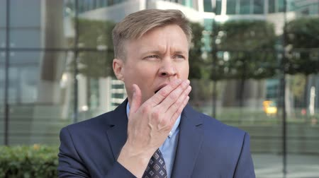 nuda : Yawning Tired Businessman in Suit