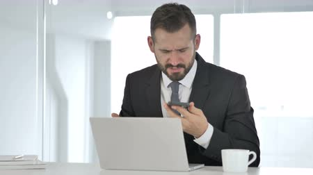 healthy office : Sick Middle Aged Businessman Coughing at Work Stock Footage