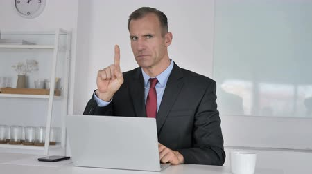 снижение : No, Middle Aged Businessman Disliking Offer by Waving Finger Стоковые видеозаписи