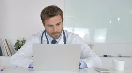 introspection : Pensive Doctor Sitting in Clinic and Thinking Stock Footage