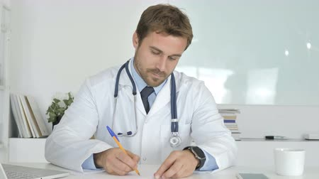 документация : Doctor Writing Medical Report in Office, Paperwork