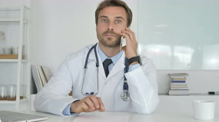 nurses : Doctor Talking on Phone Stock Footage