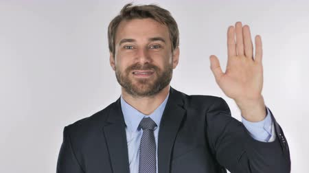 welcome sign : Portrait of Businessman Waving Hand to Welcome Stock Footage