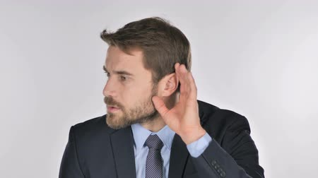 know : Handsome Businessman Listening Secret White Background