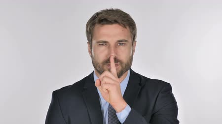 ネクタイ : Portrait of Businessman Gesturing Silence, Finger on Lips