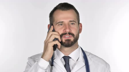 physician : Old Doctor Talking on Smartphone, White Background
