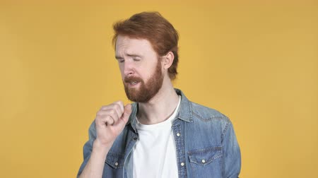 coughing : Sick Redhead Man Coughing Isolated on Yellow Background Stock Footage