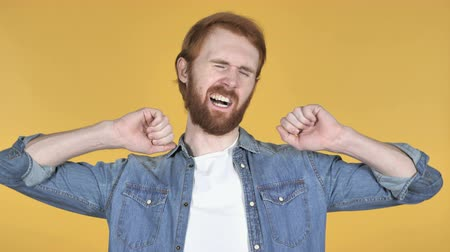 nuda : Redhead Man Yawning and Stretching BodyIsolated on Yellow Background