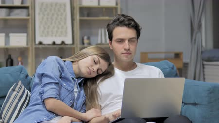 wife : Happy Man Using Laptop while Sleeping Girlfriend Head on His Shoulder