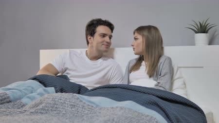 hallgat : Talking Happy Couple Relaxing in Bed and Discussing Future