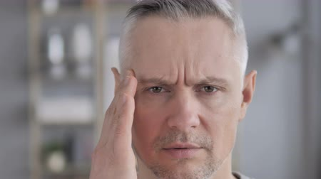 disturbed : Gray Hair Man with Headache Stock Footage