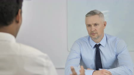 use laptop : Gray Hair Businessman Listening At Work, Discussing Work