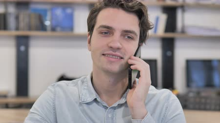 Portrait of Creative Man Talking on Phone in Office