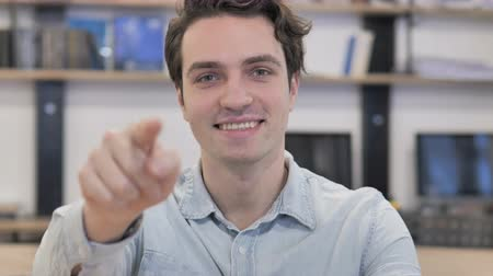 invite : Man Pointing toward Camera