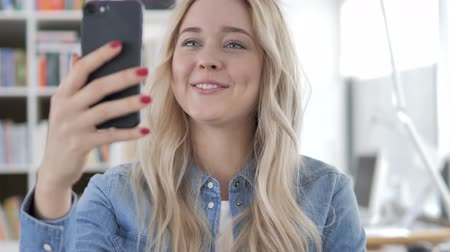 Online Video Chat on Phone by Young Woman