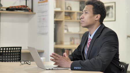 internar : Pensive African Businessman Thinking at Work Stock Footage