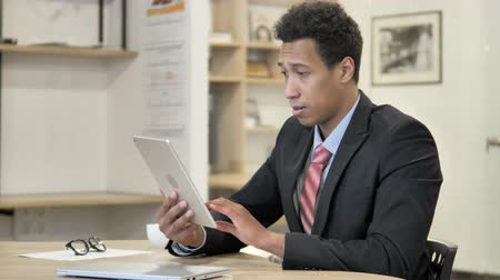 e mail address : African Businessman Browsing on Tablet Stock Footage