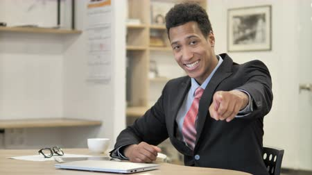 invite : African Businessman Pointing toward Camera Stock Footage