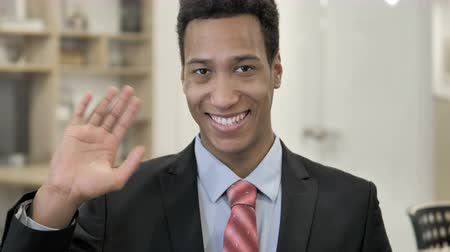интерн : Hello, African Businessman Waving Hand Стоковые видеозаписи