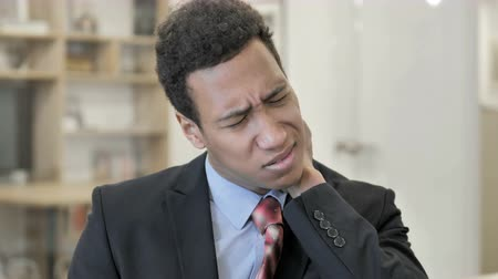 African Businessman with Neck Pain