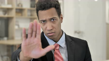 Stop, African Businessman Stopping with Hand Stock mozgókép