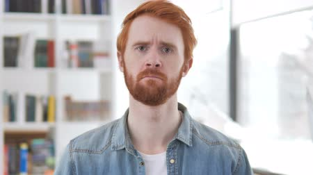 desperate student : Portrait of Sad Casual Redhead Man Upset by Loss