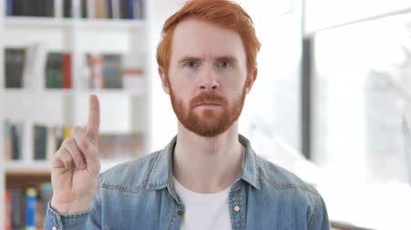 femme rousse : Casual Redhead Man Waving Finger to Reject