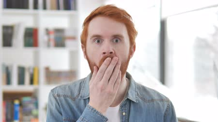 beard man : Casual Redhead Man in Shock