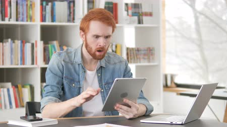 broda : Upset Casual Redhead Man Facing Loss on Tablet